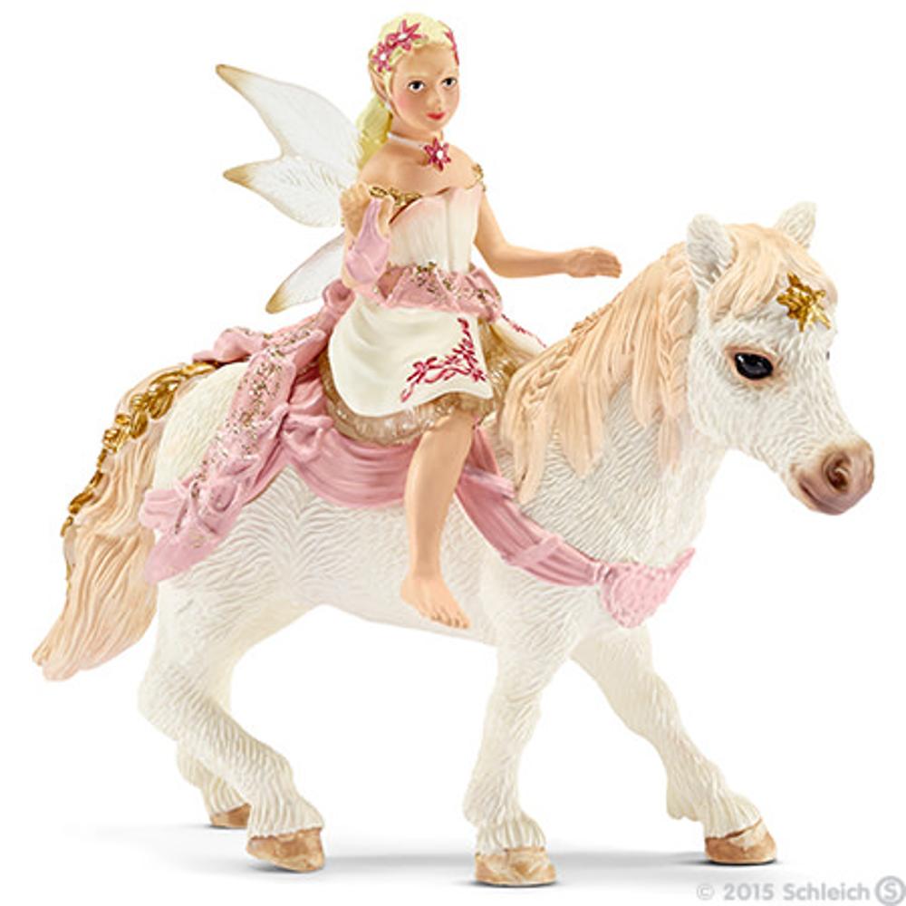 Lilienzarte Elfe, auf Pony reitend